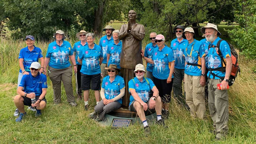 Peace walkers at the Sri Chinmoy statue